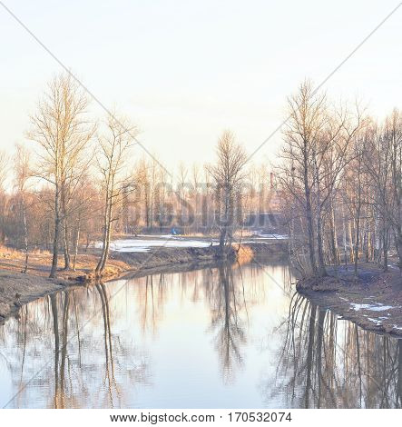 View of Slav River on the outskirts of St. Petersburg at sunny spring evening Russia.