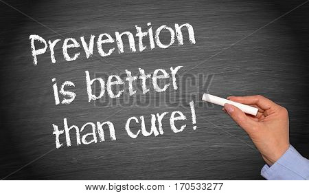 Prevention is better than cure - female hand writing text