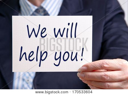 We will help you - Businesswoman with sign and text