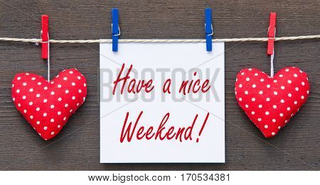 Have a nice Weekend - two red hearts with note paper and text