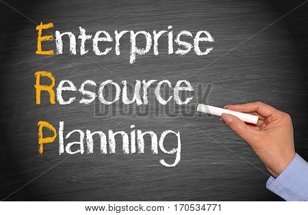 ERP - Enterprise Resource Planning - female hand writing text