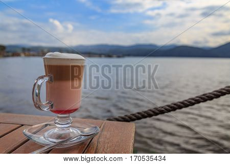 Raspberry mocha on the table with beach view