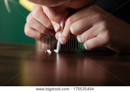 Young Boy Sniffing Crystalline Cocaine