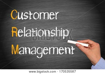 CRM - Customer Relationship Management - female hand writing text on chalkboard