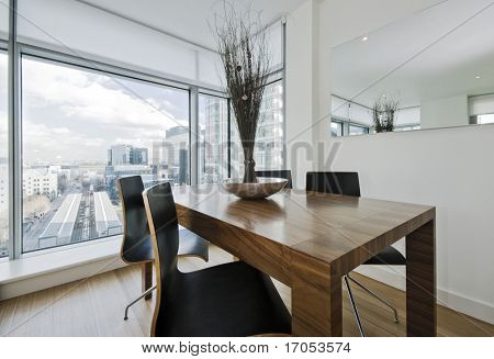 hard wood chunky dining table with chairs and decoration