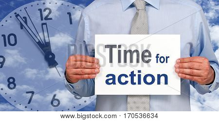 Time for action - Businessman holding sign with text, clock in the background