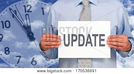 Update - Businessman with sign and clock in the background
