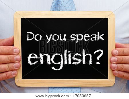 Do you speak english - Businessman holding chalkboard with text