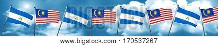 nicaragua flag with Malaysia flag, 3D rendering