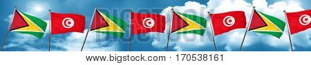 Guyana flag with Tunisia flag, 3D rendering