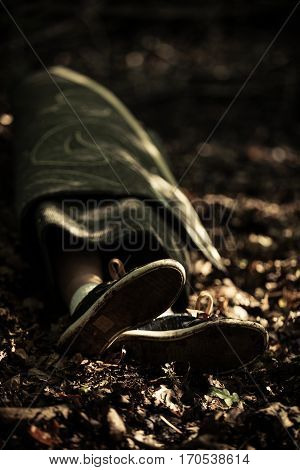 Boys Corpse Lying Out In Woodland In Darkness