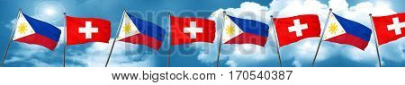 Philippines flag with Switzerland flag, 3D rendering