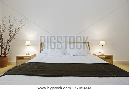 modern double bedroom with hard wood furniture