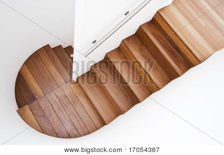 luxurious modern wooden staircase with curved landing wall