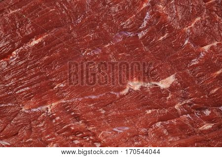 Fragment of a beef meat texture as a backdrop composition