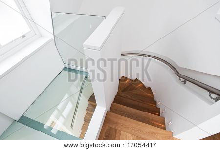 amazing wooden staircase with glass floor landing
