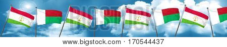 Tajikistan flag with Madagascar flag, 3D rendering