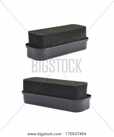 Black shoe polish sponge isolated over the white background, set of two different foreshortenings