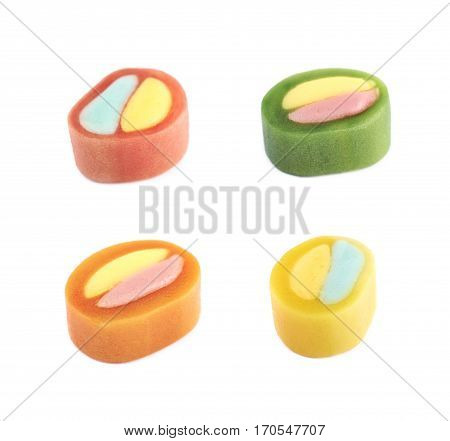 Single licorice candy isolated over the white background, set of four different foreshortenings