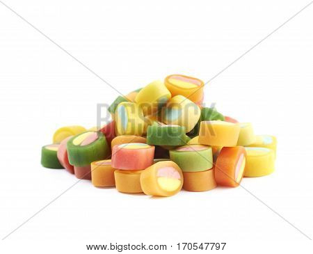 Pile of multiple colorful licorice candies isolated over the white background