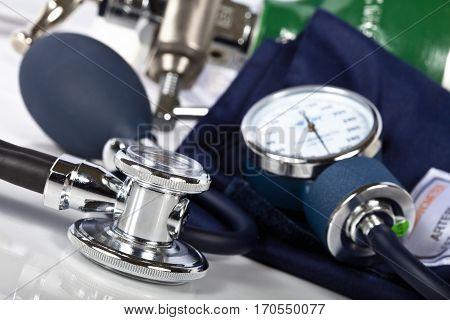 Macro shot of stethoscope and blood pressure cuff.
