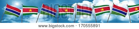 Gambia flag with Suriname flag, 3D rendering