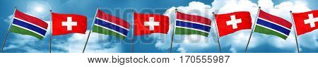 Gambia flag with Switzerland flag, 3D rendering