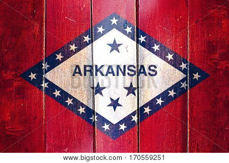 Vintage arkansas flag on grunge wooden panel