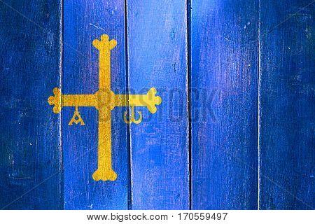 Vintage Asturias flag on grunge wooden panel