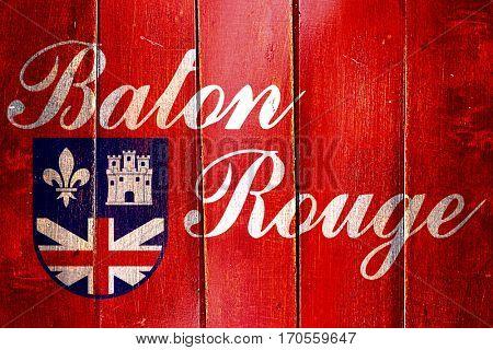 Vintage Baton rouge flag on grunge wooden panel