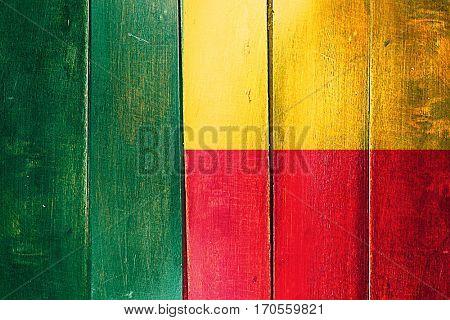 Vintage Benin  flag on grunge wooden panel