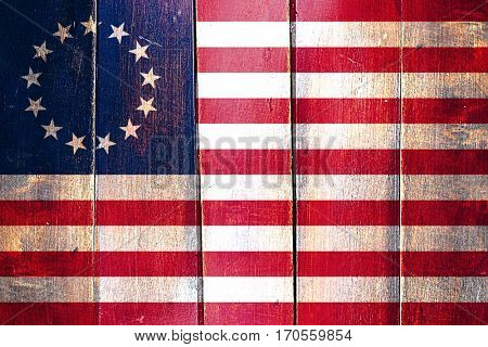 Vintage Betsy ross american early design flag on grunge wooden p