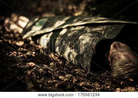 Dead Body Of A Teenage Boy Lying In A Forest