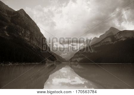 Lake Louise at sunrise in Banff national park with mountains and forest in Canada.