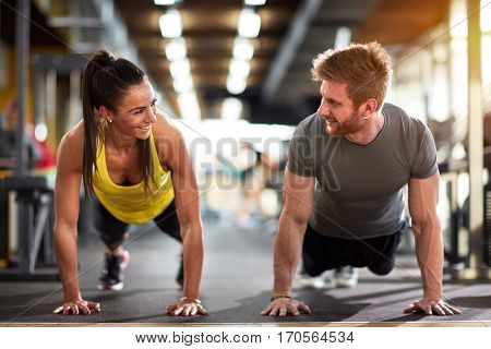 Female and male compete in endurance on fitness training