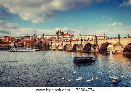 view of the Charles Bridge which crosses the River Vltava and St. Vitus Cathedral in Prague. Czech Republic