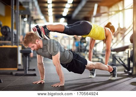 Trained couple in good condition in gym