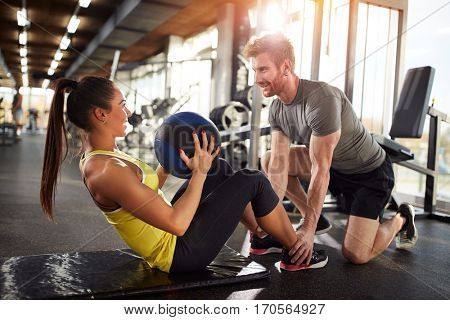 Girl in good shape on fitness training in gym