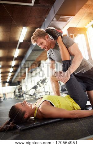 Woman with trainer in fitness center train