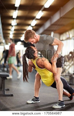 Young couple rejoices in training together in fitness center