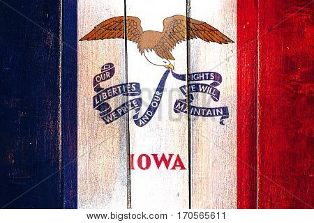 Vintage iowa flag on grunge wooden panel