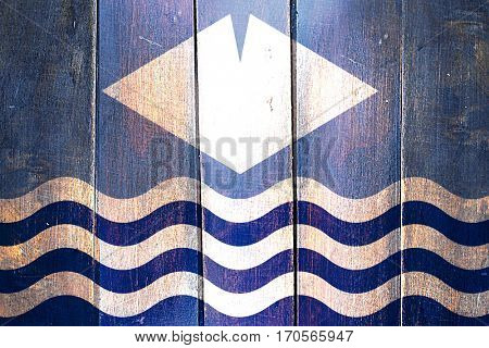 Vintage Isle of wight flag on grunge wooden panel
