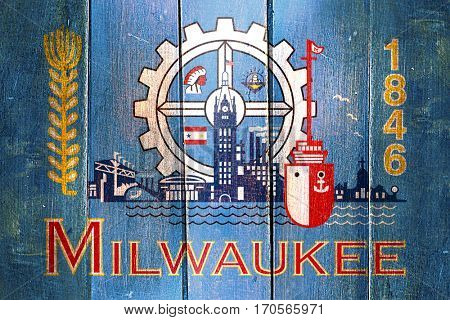 Vintage Milwaukee flag on grunge wooden panel