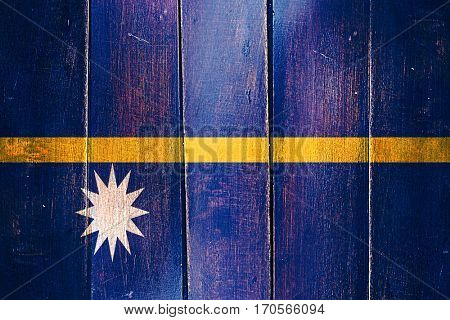 Vintage Nauru  flag on grunge wooden panel