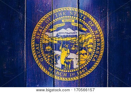 Vintage nebraska flag on grunge wooden panel