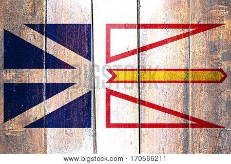 Vintage Newfoundland and labrador flag on grunge wooden panel