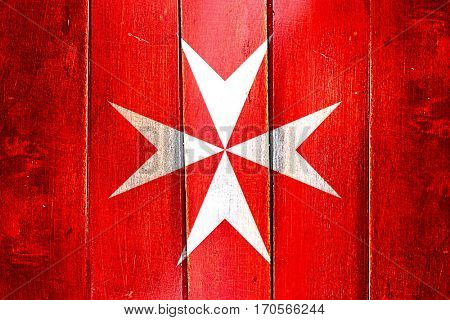 Vintage Malta knights  flag on grunge wooden panel