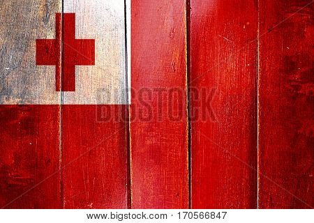 Vintage Tonga  flag on grunge wooden panel