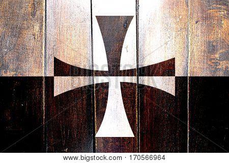 Vintage Teutonic knights flag on grunge wooden panel