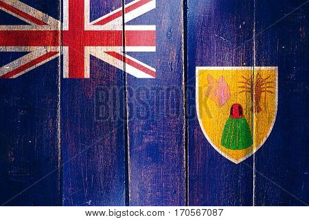 Vintage Turks and caicos islands flag on grunge wooden panel